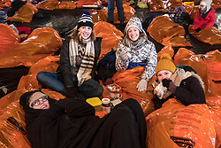 Edinburgh, United Kingdom. 9 December,2017. Sleep in the Park, held in Princes Street Gardens in Edinburgh, will see almost 9000 people sleep outdoors to raise money and awareness of homelessness. Participants cheerfully bedding down for the night in survival bags in freezing temperatures.