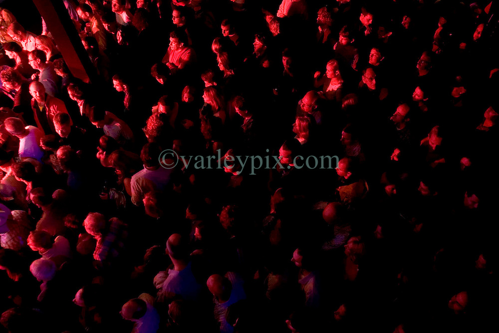 17 December, 05. Tipitina's, New Orleans, Louisiana.<br />  Arlo Guthrie and friends Riding on the city of New Orleans tour benefiting Musicares Hurricane relief 2005 sponsored by Amtrak. Music fans take in and enjoy the show.<br /> Photo; ©Charlie Varley/varleypix.com