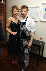 TOM AIKENS and AMBER NUTTALL at a St.Valentine's dinner hosted by Ruinart champagne at Tom Aikens Restaurant, Elystan Street, London on 6th February 2007.<br />