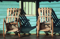 Chairs leaning against a house on a verandah in Vinales; Cuba,