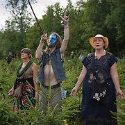 A shaman and fellow spirital followers in a field of Christmas trees put a spell on the Cuadrilla drill site. Anti-fracking activists join hands to surround the Cuadrilla fracking site. Thousands turned out for a march of solidarity against fracking in Balcombe. The village Balcombe in Sussex is the  centre of fracking by the company Cuadrilla. The march saw anti-fracking movements from the Lancashire and the North, Wales and other communities around the UK under threat of gas and oil exploration by fracking.
