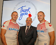 Thomas Burgess(left) with Simon O'Leary, Royal British Legion's Assistant director of fundraising and Geaorgess Burgess (right) during the official launch of the England Rugby League Remembrance Shirt at Imperial War Museum North, Trafford Park, Manchester<br /> Picture by Steve McCormick/Focus Images Ltd 07545 862647<br /> 15/10/2018
