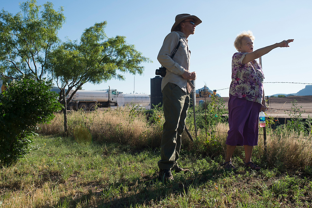 Suzanne Bailey speaks with David Keller, an archeologist at Sul Ross University and head of the Big Bend Conservation Alliance, next to a Pumpco site just feet from her home that will be used for a future natural gas pipeline in Alpine, Texas on June 17, 2015. (Cooper Neill for The Texas Tribune)