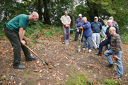 Ranger and volunteers at Bestwood Country Park, Nottingham, part of Sherwood Forest, at conservation project, learning tool technique.