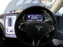 LONDON, ENGLAND - Saturday, June 7, 2014: Invited guests take a look at the right-hand drive specification of the Model S at the UK launch of Tesla Motors' Model S electric car at the Crystal. (Pic by David Rawcliffe/Propaganda)