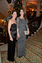 Left to right, sisters AMY GILLIAM and HOLLY GILLIAM daughters of Terry Gilliam at the Claridge's Christmas Tree By Dolce & Gabbana Launch Party held at Claridge's, Brook Street, London on 26th November 2013.