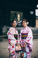 Two tourists dressed in traditional Japanese robes at Dazaifu Shrine on Kyushu island.