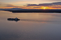 The container ship, m/v Horizon Kodiak, departs the Port of Anchorage at 11:30 PM and heads south past Mount Susitna during Anchorage's long summer twilight. Along with Totem Ocean Trailer Express, these ships bring 80% of all goods conumed by 80%of Alaskans through the port of Anchorage.