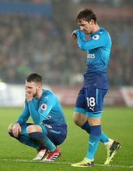 Arsenal's Aaron Ramsey (left) and Nacho Monreal look dejected during the Premier League match at the Liberty Stadium, Swansea.