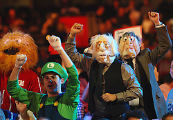 Fans celebrate during the England's Terry Jenkins, Co Stompe of the Netherlands match, which Terry Jenkins won to move to the next round in the Darts World Championships at Alexandra Palace, London, Tuesday, Dec.. 27, 2011. photo by morn/I-Images