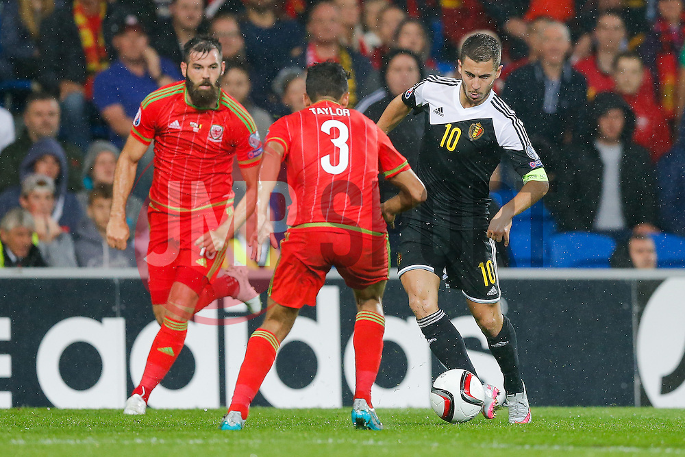 Eden Hazard of Belgium (Chelsea) is challenged by Neil Taylor of Wales (Swansea City) - Photo mandatory by-line: Rogan Thomson/JMP - 07966 386802 - 12/06/2015 - SPORT - FOOTBALL - Cardiff, Wales - Cardiff City Stadium - Wales v Belgium - EURO 2016 Qualifier.