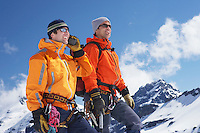 Two mountain climbers standing on peak