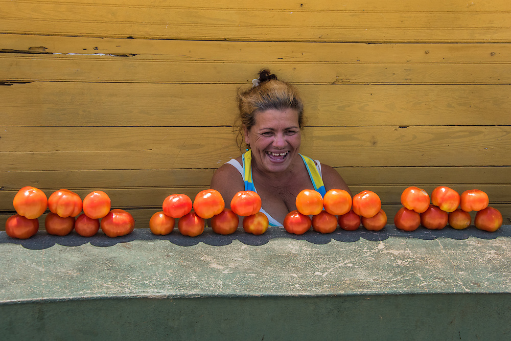 A woman sells tomatoes on the street in Cayo Granma, Santiago, Cuba.