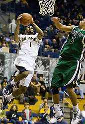December 28, 2009; Berkeley, CA, USA;  California Golden Bears guard D.J. Seeley (1) shoots past Utah Valley Wolverines guard Shawn Deadwiler (3) during the second half at the Haas Pavilion.  California defeated Utah Valley 85-51.
