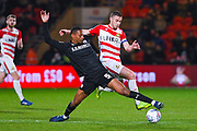 Ethan Pinnock of Barnsley (5) and Tommy Rowe of Doncaster Rovers (10) during the EFL Sky Bet League 1 match between Doncaster Rovers and Barnsley at the Keepmoat Stadium, Doncaster, England on 15 March 2019.