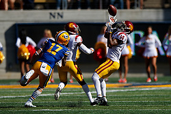 BERKELEY, CA - SEPTEMBER 23:  Safety Ykili Ross #14 of the USC Trojans intercepts a pass intended for wide receiver Vic Wharton III #17 of the California Golden Bears during the fourth quarter at California Memorial Stadium on September 23, 2017 in Berkeley, California. The USC Trojans defeated the California Golden Bears 30-20. (Photo by Jason O. Watson/Getty Images) *** Local Caption *** Ykili Ross; Vic Wharton III