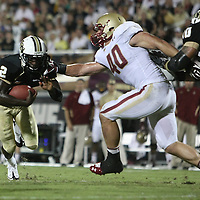 Boston College linebacker Luke Kuechly (40) grabs Central Florida quarterback Jeff Godfrey (2) during an NCAA football game between the Boston College Eagles and the UCF Knights at Bright House Networks Stadium on Saturday, September 10, 2011 in Orlando, Florida. (AP Photo/Alex Menendez)