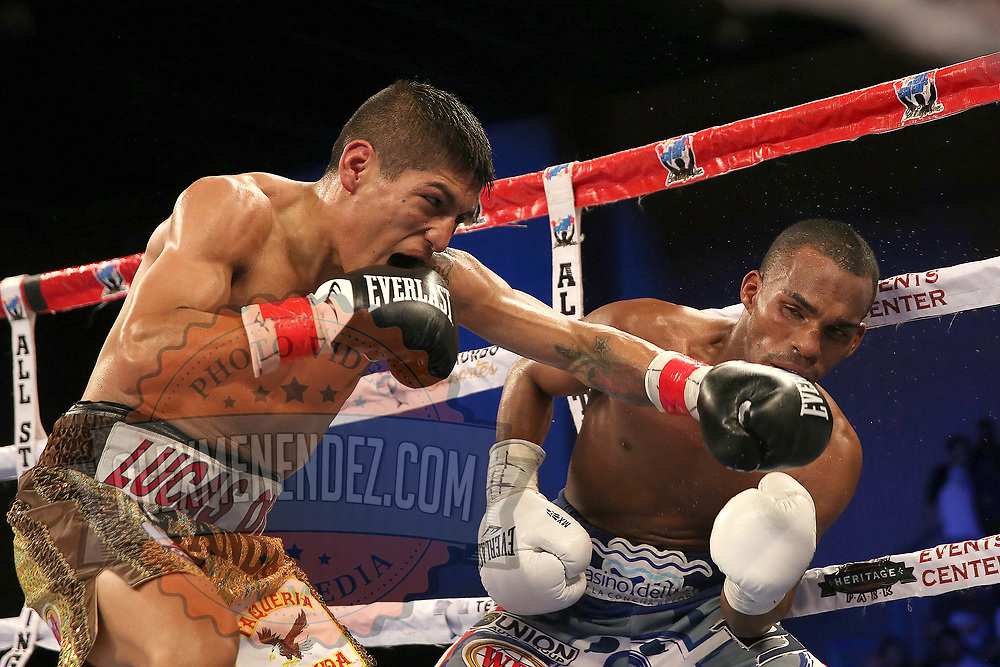 Richard Rodriguez (L) lands a shot the head of Jonathan Gonzalez during a Telemundo boxing match between at Osceola Heritage Park on Friday, February 23, 2018 in Kissimmee, Florida.  (Alex Menendez via AP)