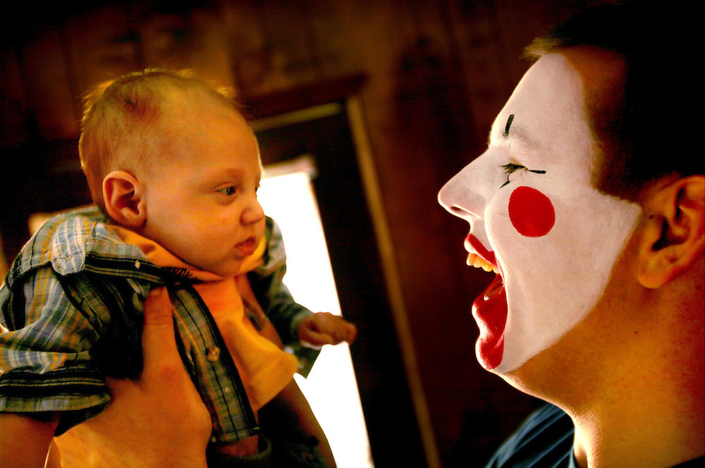 Aaron L. Clark holds his son, Zander Kelly Clark before heading off to a freelance as Ziggy the Clown. Zander was born August 17th, 2006 with Hypoplastic Left Heart Syndrome, and had heart surgery the first day he was born. Aaron, who is a full-time clown in Roanoke, Virgina, also freelances as a clown to help pay for Zander's heart operations, the next of which is scheduled for January.