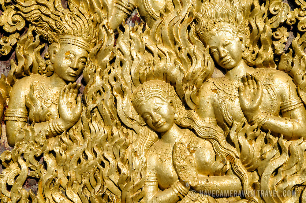 Ornate gold decorations at Wat Xieng Thong (Temple of the Golden City) on the northern tip of the peninsula of Luang Prabang, Laos. Originally built around 1560, the temple was the main site for royal coronations and remains ones of the most important temples in Laos.