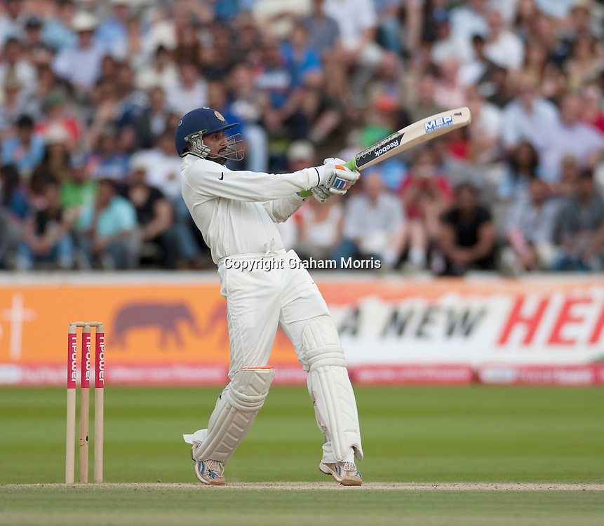 Harbhajan Singh is caught by Chris Tremlett off the bowling of James Anderson during the first npower Test Match between England and India at Lord's Cricket Ground, London.  Photo: Graham Morris (Tel: +44(0)20 8969 4192 Email: sales@cricketpix.com) 25/07/11