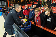 Referee Kevin Friend hand out a Kick It Out shirts to a young fans ahead of the Premier League match between Bournemouth and Brighton and Hove Albion at the Vitality Stadium, Bournemouth, England on 21 January 2020.