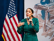 """09 NOVEMBER 2019 - DES MOINES, IOWA: Congresswoman ALEXANDRIA OCASIO-CORTEZ (D-NY) speaks at a climate change town hall organized by Senator Bernie Sanders' presidential campaign. Sanders and Ocasio-Cortez hosted the """"Climate Crisis Summit"""" at Drake University in Des Moines. More than 2,000 people attended the event. Sanders, an independent, is running to be the Democratic nominee for the 2020 US Presidential election. Iowa holds the first in the country selection contest with state caucuses on Feb. 3, 2020.              PHOTO BY JACK KURTZ"""