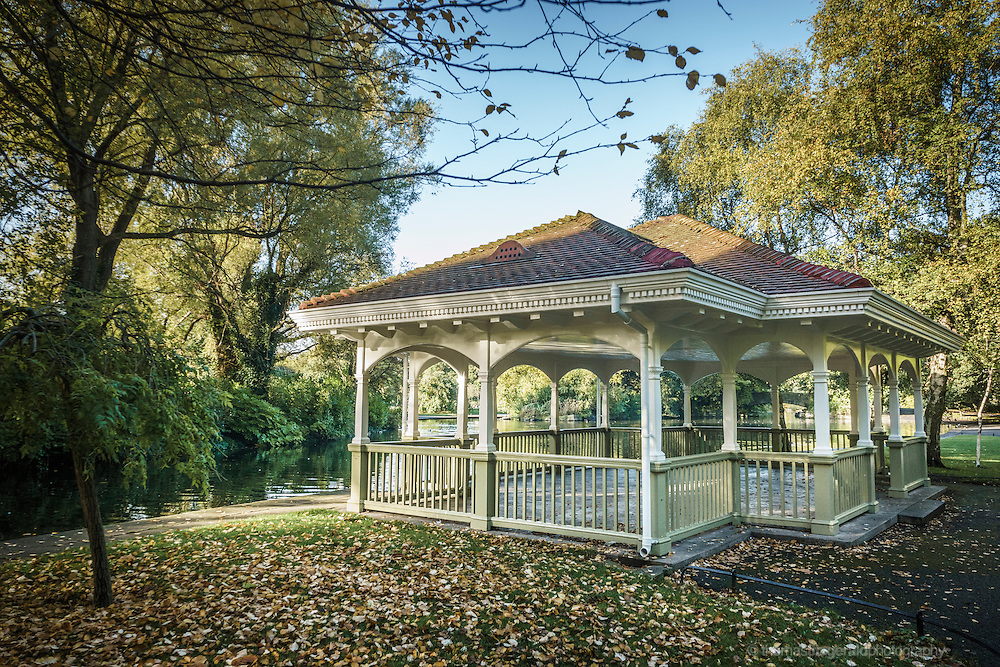 Fallen Autumn leaves surround the pretty and picturesque gazebo in the centre of the Stephen's green park in Dublin