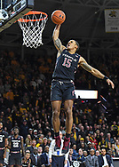 Temple Owls guard Nate Pierre-Louis (15) drives to the basket for a brake away dunk during overtime against the Wichita State Shockers at Charles Koch Arena.