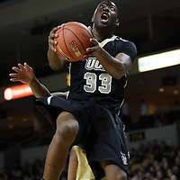 Central Florida forward Keith Clanton (33) takes it to the hoop during the NCAA basketball game against the USF Bulls at the UCF Arena on November 18, 2010 in Orlando, Florida. UCF won the game 65-59. (AP Photo/Alex Menendez)