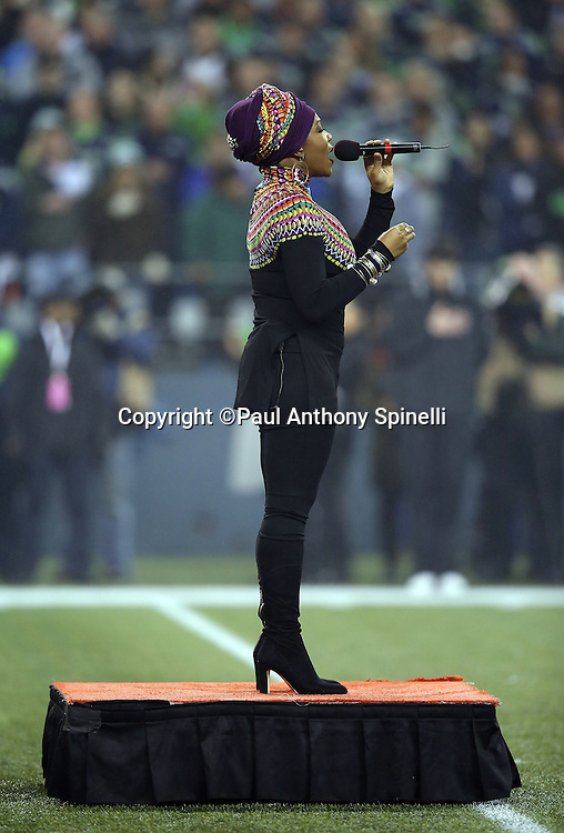 India.Arie sings the National Anthem before the Seattle Seahawks NFL week 19 NFC Divisional Playoff football game against the Carolina Panthers on Saturday, Jan. 10, 2015 in Seattle. The Seahawks won the game 31-17. ©Paul Anthony Spinelli