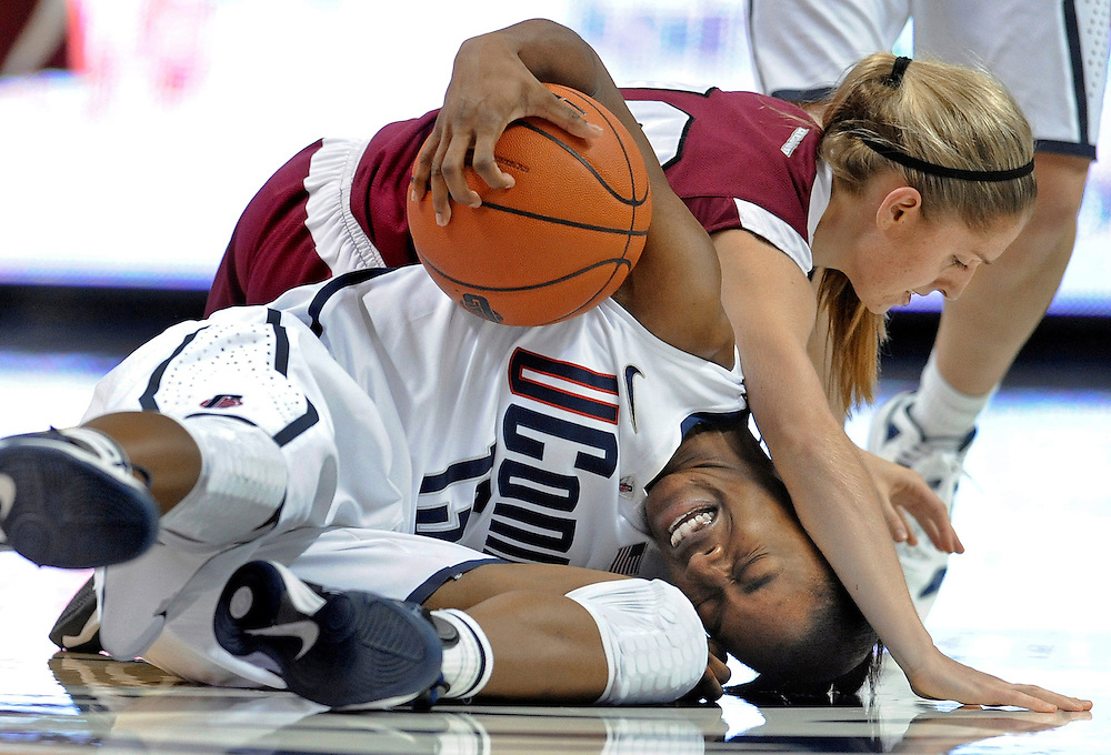 Connecticut's Brianna Banks, bottom and Indiana of Pennsylvania's Marina Wareham tussle for the ball during the second half of a college exhibition basketball game in Storrs, Conn.(AP Photo/Jessica Hill)