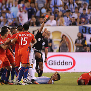 EAST RUTHERFORD, NEW JERSEY - JUNE 26: Marcos Rojo #16 of Argentina is sent off by Brazilian referee Heber Lopes who shows the red card during the Argentina Vs Chile Final match of the Copa America Centenario USA 2016 Tournament at MetLife Stadium on June 26, 2016 in East Rutherford, New Jersey. (Photo by Tim Clayton/Corbis via Getty Images)