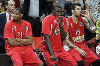 Olympiacos Piraeus' Tremmell Darden, Othello Hunter and Georgios Printezis dejected after Euroleague Final Match. May 15,2015. (ALTERPHOTOS/Acero)