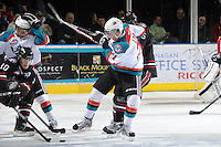 KELOWNA, CANADA - FEBRUARY 18:  Brett Lyon #21 of the Kelowna Rockets makes a check against the Red Deer Rebels at the Kelowna Rockets on February 18, 2012 at Prospera Place in Kelowna, British Columbia, Canada (Photo by Marissa Baecker/Shoot the Breeze) *** Local Caption ***