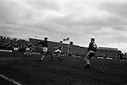 21/04/1963<br /> 04/21/1963<br /> 21 April 1963 <br /> Soccer: Cork Hibernians v Shelbourne, F.A.I. Cup Semi-final at Dalymount Park, Dublin. Tony Corrigan of shells clears his lines under pressure from Johnny Kingston of Hibs. centre forward.