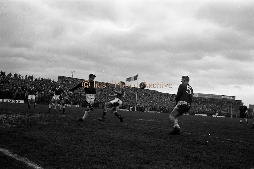 21/04/1963<br /> 04/21/1963<br /> 21 April 1963 <br /> Soccer: Cork Hibernians v Shelbourne, F.A.I. Cup Semi-final at Dalymount Park, Dublin. Tony Corrigan of shells clears his lines under pressure from Johnny Kingston of Hibs. centre forward.