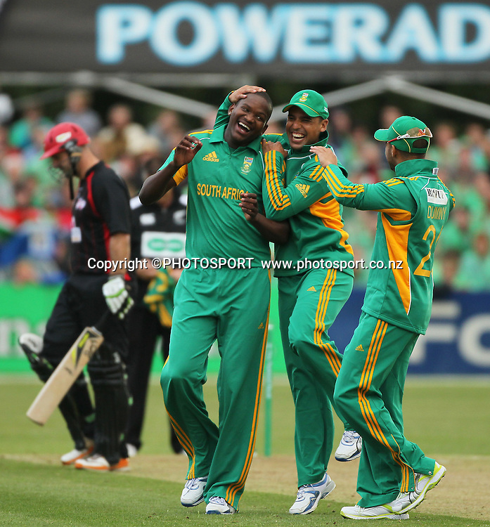 South African Lonwabo Tsotsobe gets a hat trick bowling. The last wicket being Shanan Stewart LBW, he is congratulated by Justin Ontong and JP Duminy. Canterbury Wizards v South Africa. International Twenty20 cricket match, Hagley Oval, Wednesday 15 February 2012. Photo : Joseph Johnson / photosport.co.nz