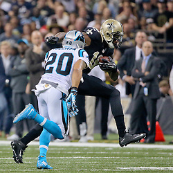 Dec 6, 2015; New Orleans, LA, USA; New Orleans Saints wide receiver Brandon Coleman (16) catches a pass over Carolina Panthers free safety Kurt Coleman (20) during the first half of a game at Mercedes-Benz Superdome. Mandatory Credit: Derick E. Hingle-USA TODAY Sports