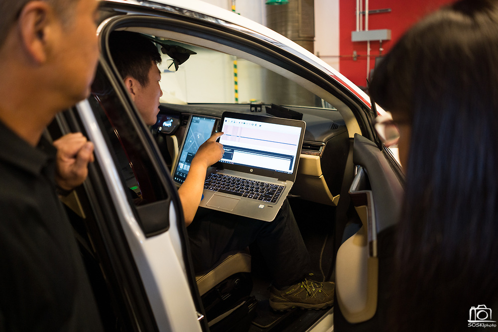 Lawrence Cao of Fresno checks error codes from a Tesla Model X during the Tesla Start class at Evergreen Valley Community College in San Jose, California, on August 8, 2019. (Stan Olszewski for Silicon Valley Business Journal)