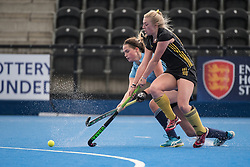 Reading's Imogen Lowe is tackled by /b186/ of Beeston. Surbiton v Beeston - Boys U18 Cup Final, Lee Valley Hockey & Tennis Centre, London, UK on 01 May 2017. Photo: Simon Parker