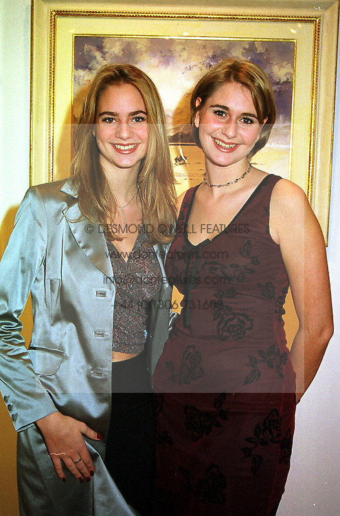 Left to right, MISS SAMANTHA HOLCROFT and her sister MISS OLIVIA HOLCROFT daughters of artist Harry Holcroft, at an exhibition in London on 8th November 1999.MYR 5