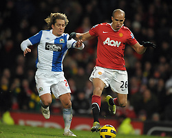 Gabriel Obertan (Man Utd)  and Michel Salgado (Blackburn) during the Barclays Premier League match between Manchester United and Blackburn Rovers at Old Trafford on November 27, 2010 in Manchester, England.