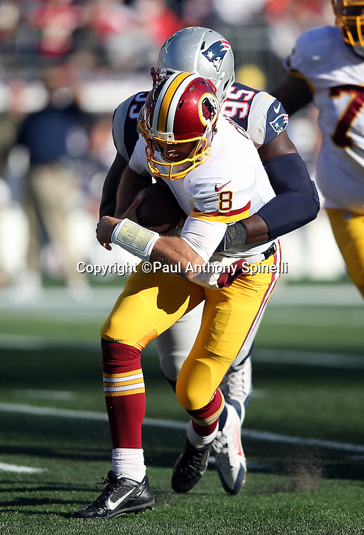 New England Patriots defensive end Chandler Jones (95) sacks Washington Redskins quarterback Kirk Cousins (8) for a 4 yard loss early in the second quarter during the 2015 week 9 regular season NFL football game against the Washington Redskins on Sunday, Nov. 8, 2015 in Foxborough, Mass. The Patriots won the game 27-10. (©Paul Anthony Spinelli)
