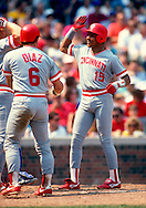 CHICAGO:  Barry Larkin celebrates with Bo Diaz of the Cincinnati Reds after Larkin hit a home run during an MLB game against the Chicago Cubs at Wrigley Field in Chicago, Illinois.  Larkin played for the Reds from 1986-2004.   (Photo by Ron Vesely)   Subject: Barry Larkin.