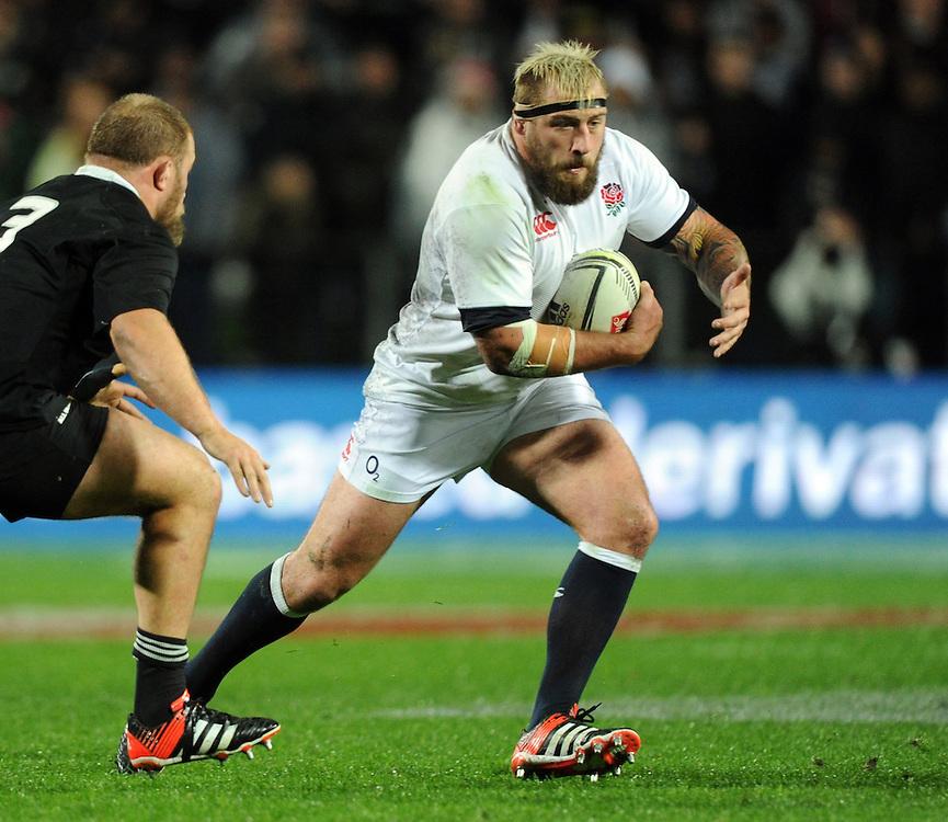 England's Joe Marler, right, runs around New Zealand's Owen Franks in the third International Rugby Test at Waikato Stadium, Hamilton, New Zealand, Saturday, June 21, 2014.Credit:SNPA / Ross Setford