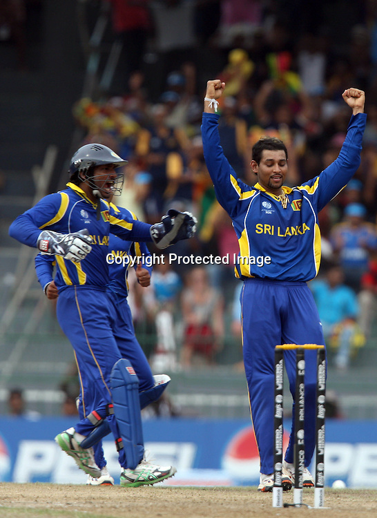 Sri Lankan bowler Tillakaratne Dilshan celebrates with captain Kumar Sangakkara England batsman Andrew Strauss wicket during the ICC Cricket World Cup - 4th Quarter-Final Played at R Premadasa Stadium, Colombo.26 March 2011 - day/night (50-over match)
