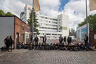 Berlin, Germany - 13.06.2017<br /> <br /> About 50 people blocked the main entrance to the conference site of the G20-Africa summit in Berlin-Schoenberg and shout slogans inter alia against deportations. Participants of the conference were taken to the site via other entrances. Some protesters also got access to a bare brickwork at the meeting site where they unfurled banners against the summit. The police detained the protesters one by one and controlled their IDs.<br /> <br /> Etwa 50 Personen blockierten die Haupteinfahrt zum Tagungsort des G20-Afrika Gipfel in Berlin-Schoeneberg, dabei skandieren sie unter anderem Parolen gegen Abschiebungen. Teilnehmer der Konferenz wurden ueber andere Zugaenge auf das Gelaende gebracht. Einige Demonstranten verschafften sich zudem Zutritt zu einem Rohbau am Tagungsgelaende wo sie Banner gegen den Gipfel entrollte. Die Polizei fuehrte die Demonstranten einzeln ab und kontrollierte die Personalien. <br /> <br /> Photo: Bjoern Kietzmann