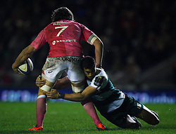 Peter Bethan of Leicester Tigers (R) tackles Sylvain Nicolas of Stade Francais - Mandatory byline: Jack Phillips / JMP - 07966386802 - 13/11/15 - RUGBY - Welford Road, Leicester, Leicestershire - Leicester Tigers v Stade Francais - European Rugby Champions Cup Pool 4