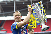 Paul Robinson defender for AFC Wimbledon (6) with the trophy. AFC Wimbledon promotion to League One, after beating Plymouth Argyle Football Club 2-0 during the Sky Bet League 2 play off final match between AFC Wimbledon and Plymouth Argyle at Wembley Stadium, London, England on 30 May 2016. Photo by Stuart Butcher.